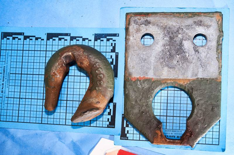 An eroded hook found on tower No. 81 on PG&E's Caribou-Palermo transmission line. Bottom: Two sets of hooks and steel plates from tower No. 01-14 and 14-117 show the area where fretting erosion occur